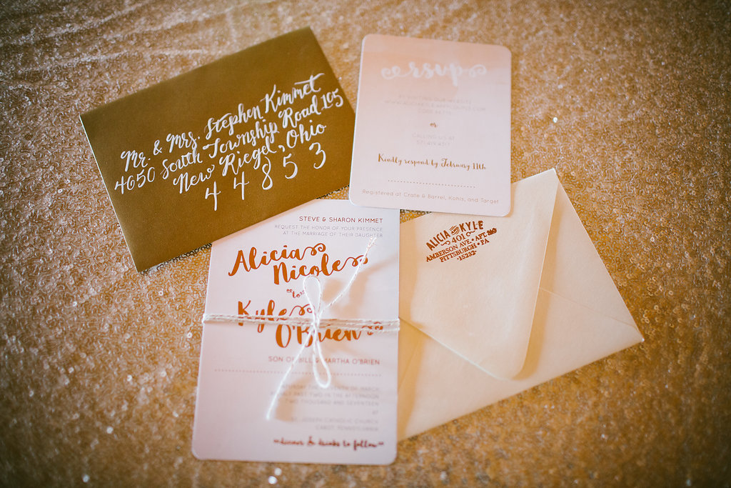 Custom wedding invitation suite with rose gold foil and modern calligraphy