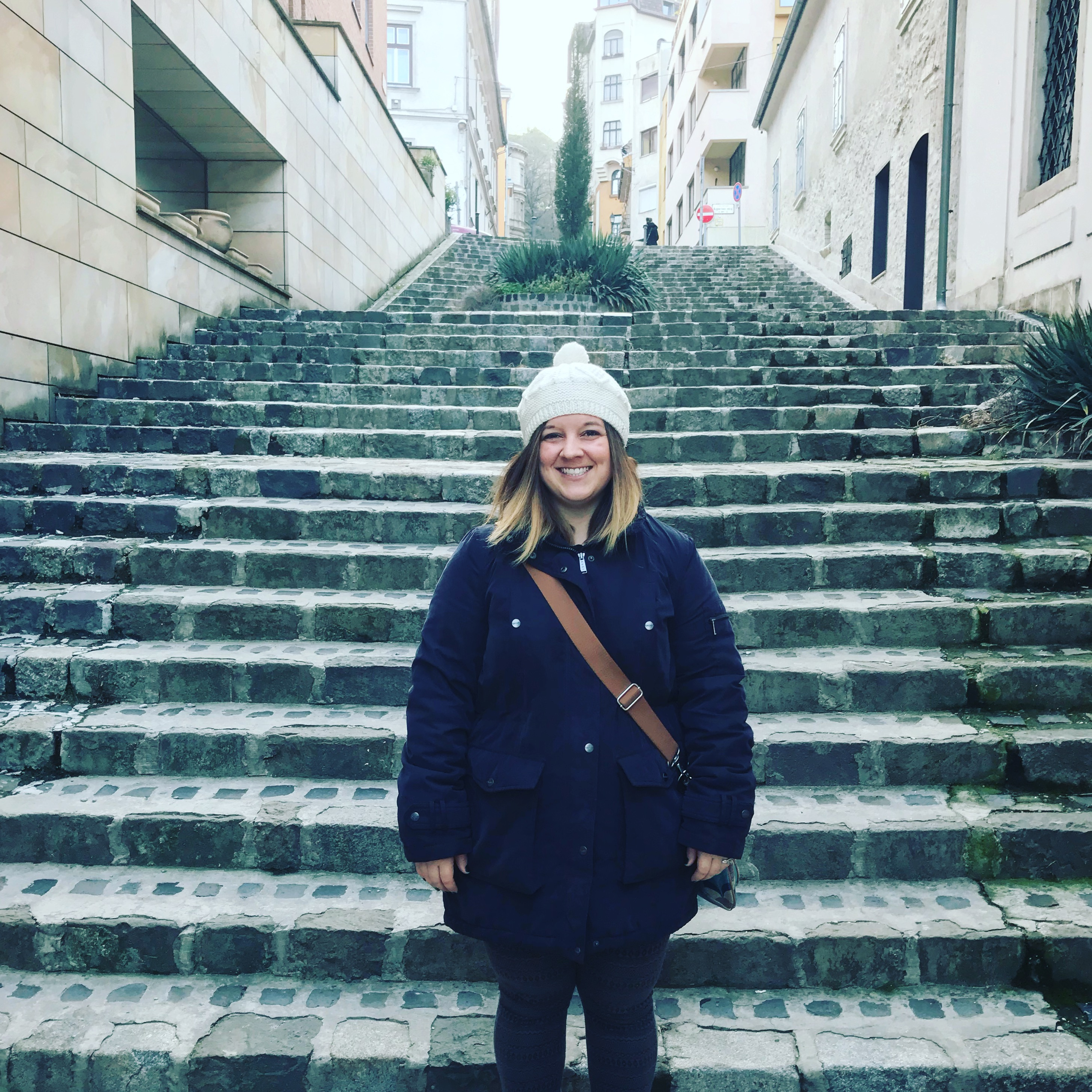 Alicia on steps with winter outfit