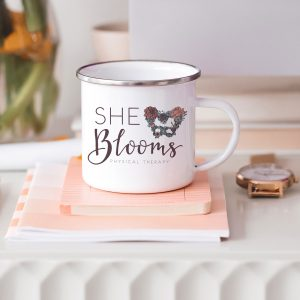 She Blooms full color logo on camp coffee mug