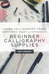Calligraphy worksheets, supplies, pens, and inks on a white desk with text overlaid: Learn calligraphy today part 2, beginner calligraphy supplies